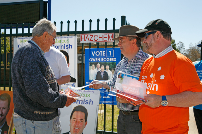 Ross Fowler and John Thain handing out how-to-vote cards at the 2012 Election