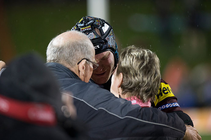 Nigel Plum embraces his parents following the game on Saturday. Photo: 77 Media / Andrew Farrell