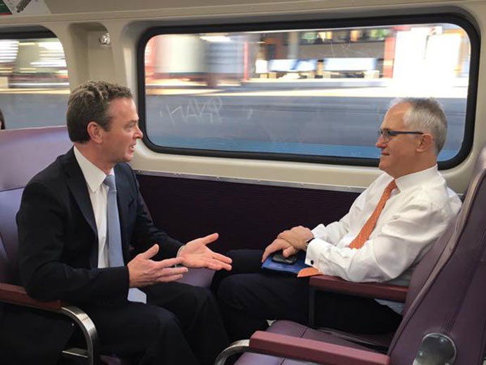 Christopher Pyne and Malcolm Turnbull on the train to Penrith this morning