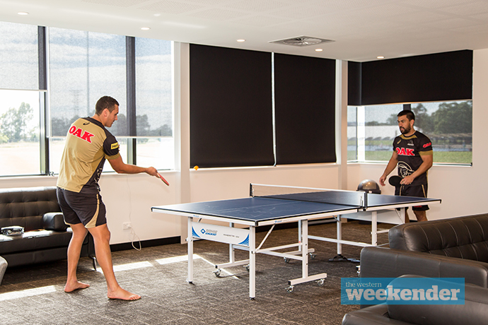 Players relax with a little table tennis in the recreation room. Photo: Megan Dunn