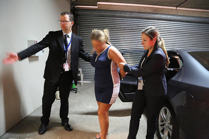 A woman is taken back to Penrith Police Station