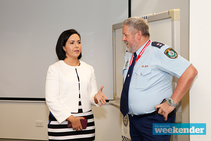 Londonderry MP Prue Car chatting with Superintendent Greg Peters