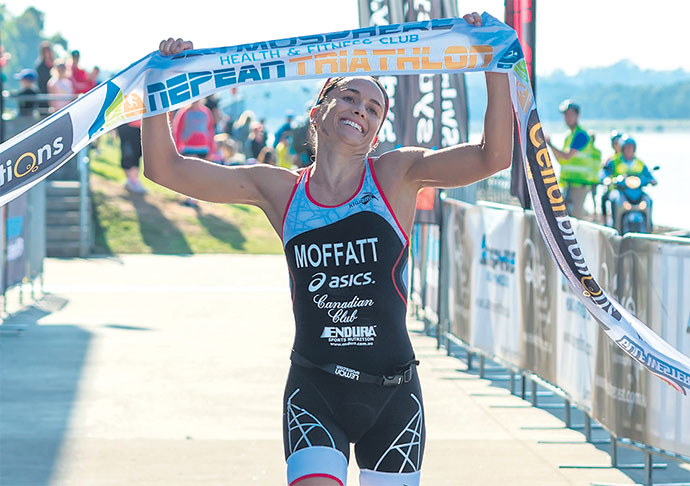 Emma Moffatt crosses the finishing line. Photo: JGRimages