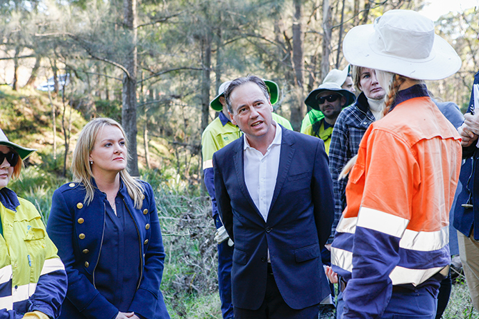 Greg Hunt and Fiona Scott with Green Army members on Wednesday. Photo: Melinda Jane