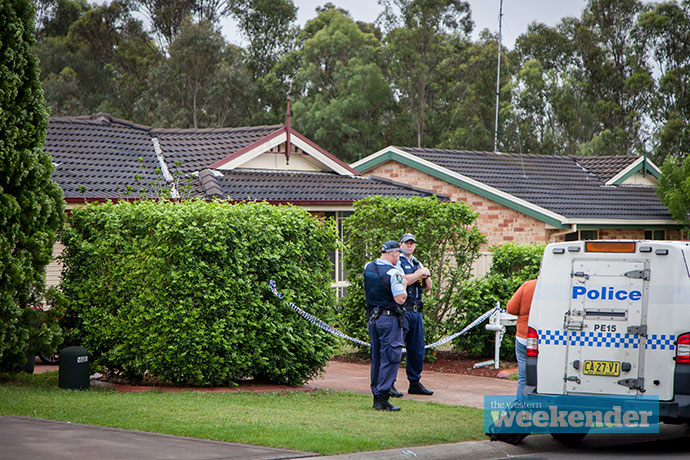 Police at the woman's home this morning. Photo: Megan Dunn
