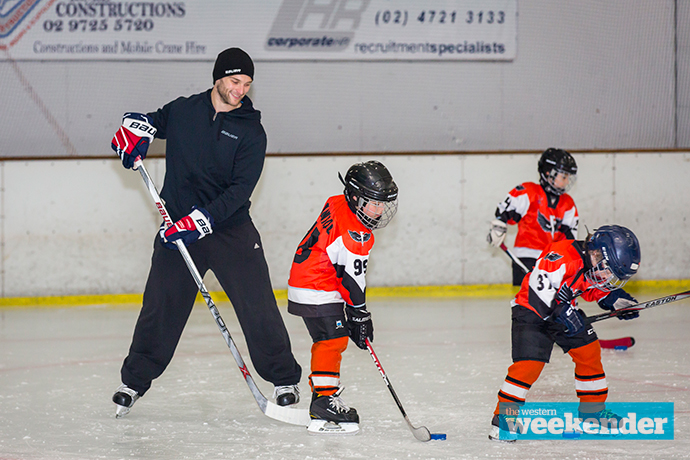Nathan Walker with kids at the Ice Palace. Photo: Megan Dunn