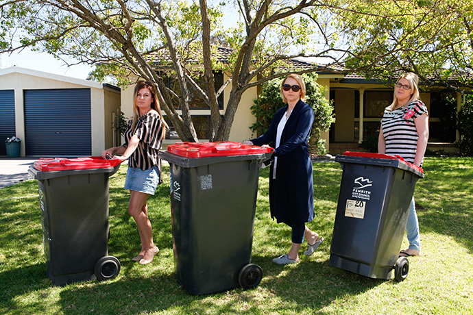 Kim, Tracey and Sue want their red lid bins picked up more frequently. Photo: Melinda Jane