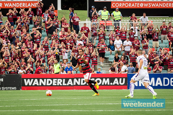 Wanderers fans support their team during a game